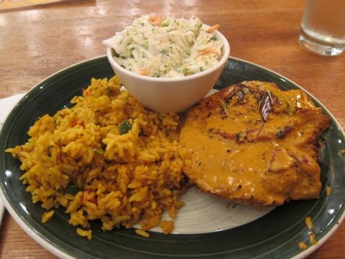 Nando's peri-peri chicken with extra spicy sauce, rice, and cole slaw in Washington, DC.