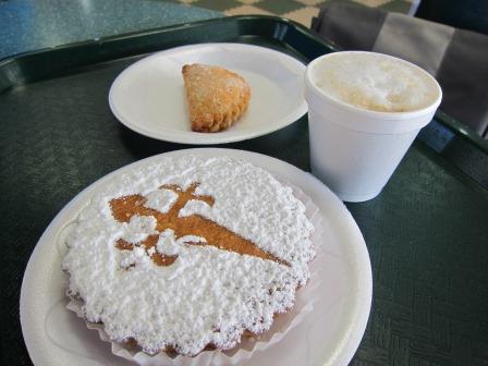 Cortadito, a pastel de guayaba, and a torta de Santiago at Versailles