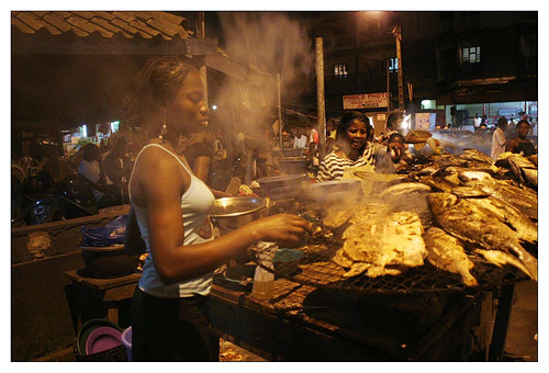 Women grilling fish at a maquis in Abidjan.